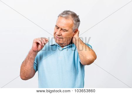 Senior man taking pills for pain in neck