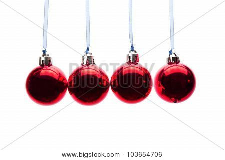 Red Christmas Balls Hanging In A Row On White Background