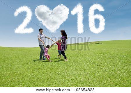 Hispanic Family Celebrate New Year At Field