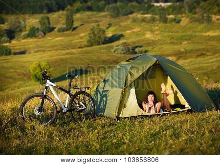 Travel With Bicycle Alone - Young Woman In The Tent