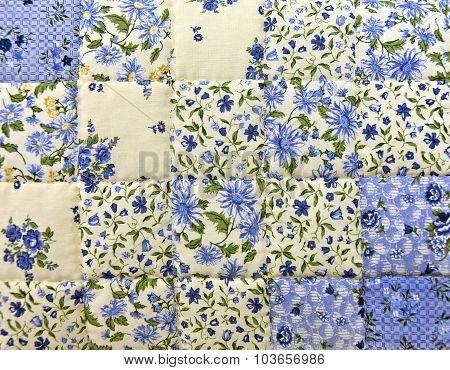 blue floral patchwork quilt