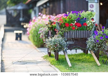 Old wooden cart rebuilt as a flower bed