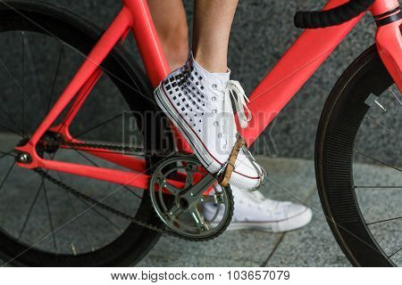 Young Woman Foot At Bicycle Pedal Closeup