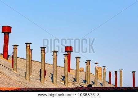 Old steel chimneys on the roof