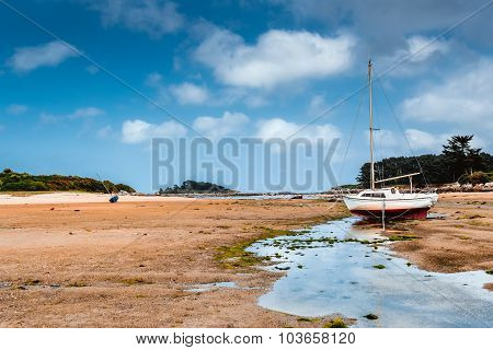 old boat on beach in Brittany in low tide