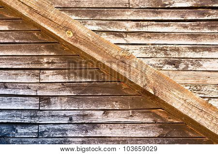 Vintage wall from wooden boards and massive joist across