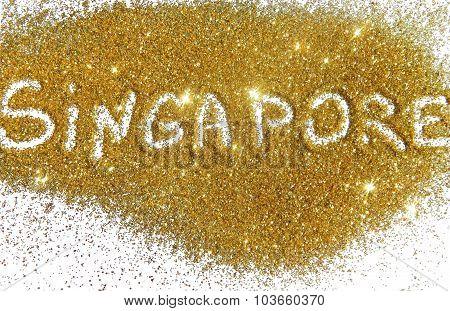 Inscription Singapore on golden glitter sparkles on white background