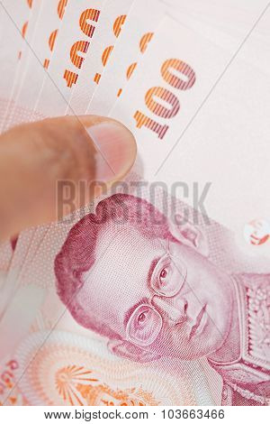 Male Hand Holding Thai Money Banknotes