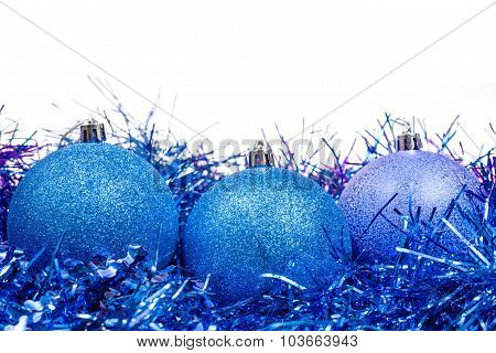 Few Blue Christmas Baubles And Tinsel Isolated