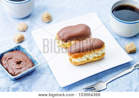 Eclairs With Cheese Cream And Chocolate Glaze