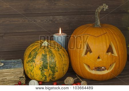 Halloween pumpkin head on wooden background. Preparing for Halloween