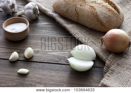 Onions, Garlic And A Loaf Of Bread