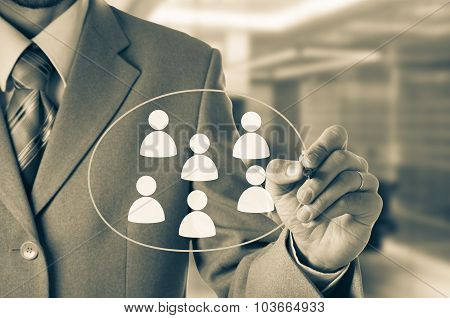 Hand pointing to businessman icon - HR recruitment and chosen concept.