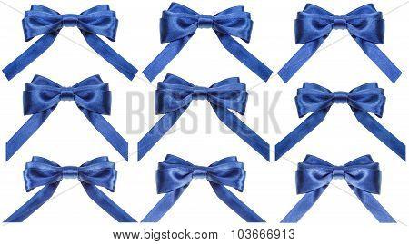 Set Of Blue Satin Bows Isolated On White