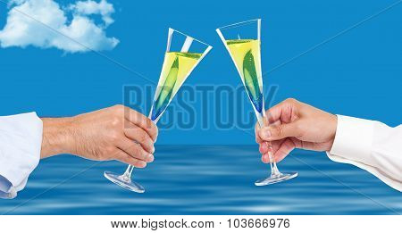 Two men hands toasting with champagne