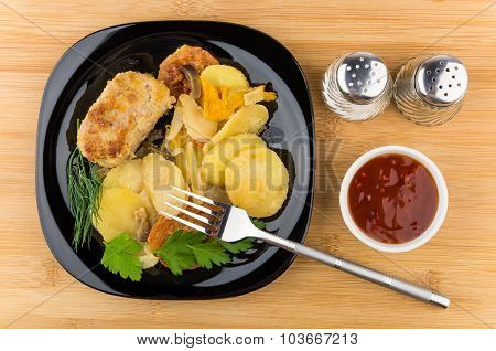 Vegetable Mix  With Cutlet In Black Plate And Ketchup