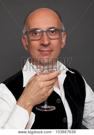 Handsome man with a martini glass