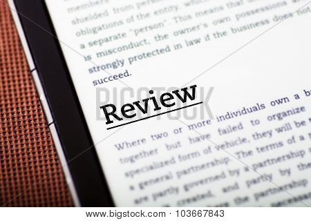 Review On Tablet Screen, Ebook Concept