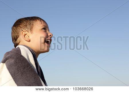 Happy Boy On A Sky Background