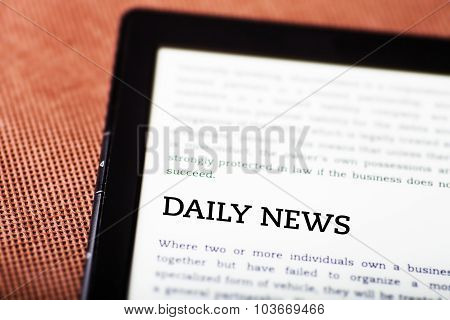 Daily News On Ebook, Tablet Concept