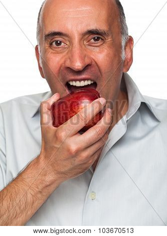 Handsome man eating an apple