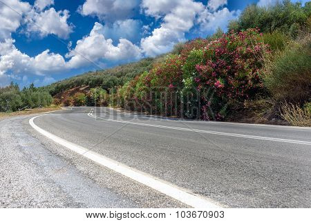 Landscape and road through mountains at western part of Crete island