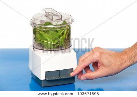 Hand using a food processor