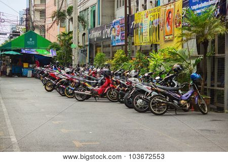 Scooters Parked Along The Street In Town. Bangkok