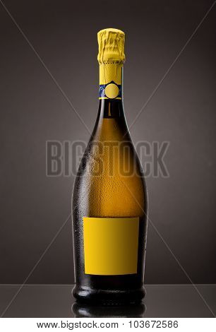 Bottle of chilled unopened champagne