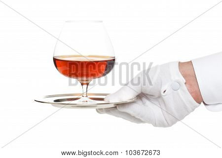 Butler serving a glass of liquor