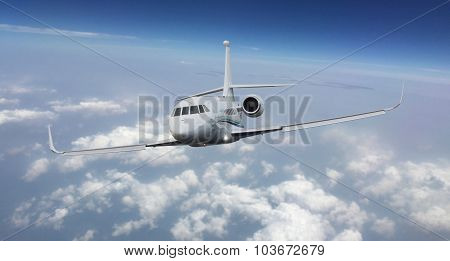 Frontal view of a private jet flying