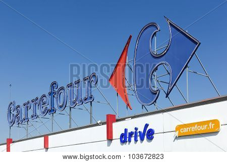 Carrefour sign on a facade