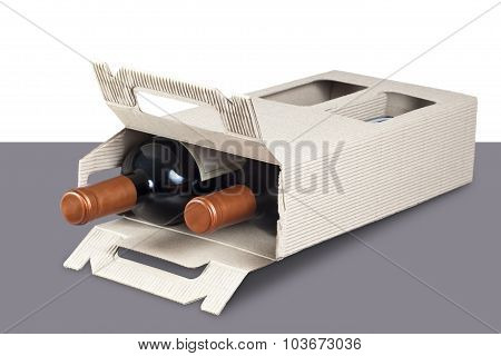Cardboard box with wine bottles in it