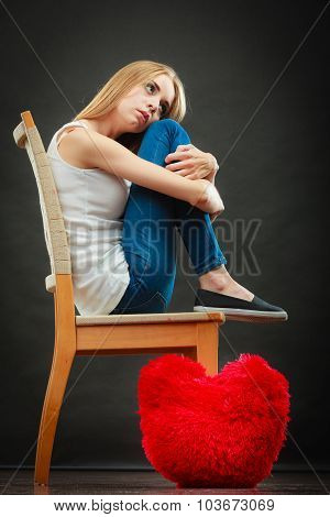 Sad Unhappy Woman With Red Heart Pillow
