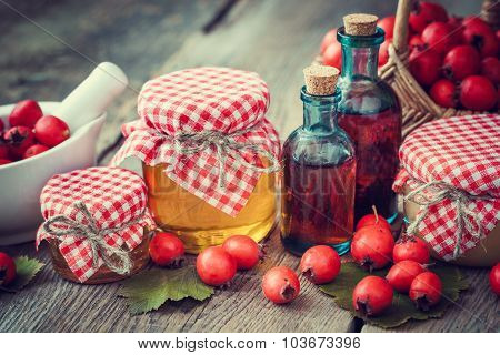 Jars Of Honey, Tincture Bottles And Mortar Of Hawthorn Berries On Table. Herbal Medicine.
