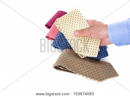 Man's hand picking a tie