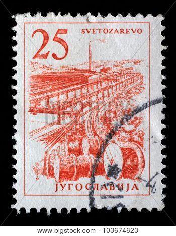 YUGOSLAVIA - CIRCA 1958: Stamp printed in Yugoslavia shows a Cable industry, Svetozarevo, with the same inscription, from series Industrial Progress, circa 1958