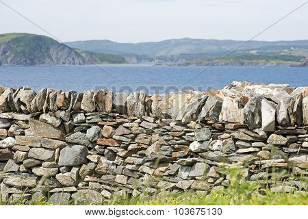 Stone Retaining Wall By The Ocean