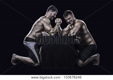 Two athletes arm wrestling
