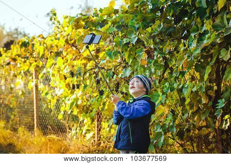 Smart Happy Little Boy Taking Selfie