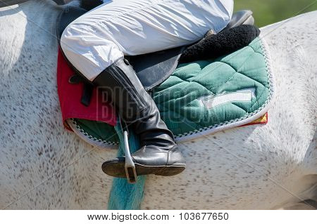 Jockey Leg Closeup Sitting On Racing Horse