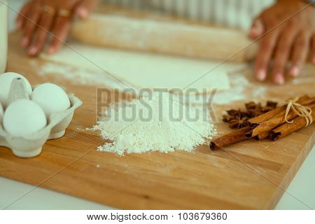 Close-up of a woman's hands baking in the kitchen