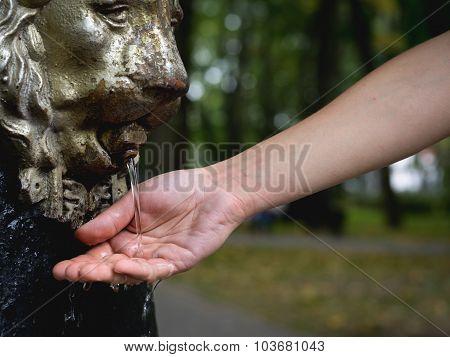 Splashing Water on Hand