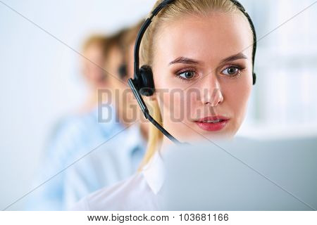 Shot of a call center operator sitting in front of her computer