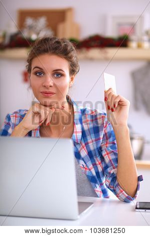 Shot of a young woman doing some online shopping
