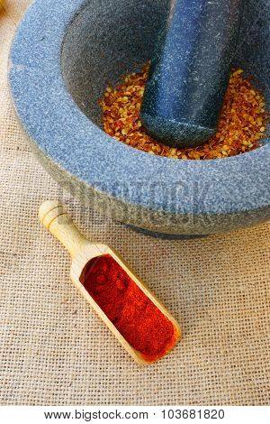 Chili Powder On Spice Scoop And Dried Chili In A Mortar