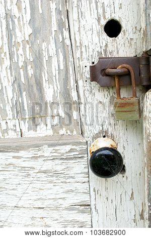 Knob And Lock On A Weatherbeaten Door