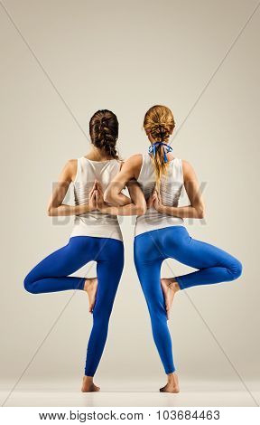 yoga in pair. balance