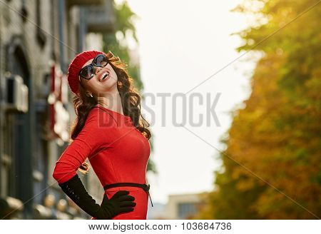 beautiful woman in red dress on the sun street