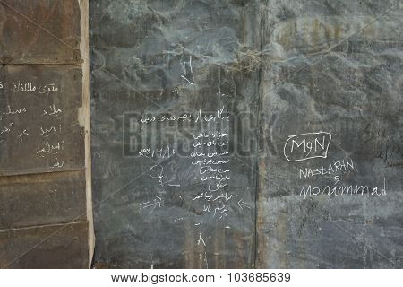 Old Brown Grunge And Rusty Metal Wall With Momentos  And Signs  Background